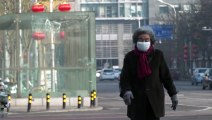 China stutters back to work as virus deaths rise