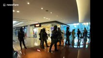 Chaos in Hong Kong as riot police use pepper spray inside shopping mall