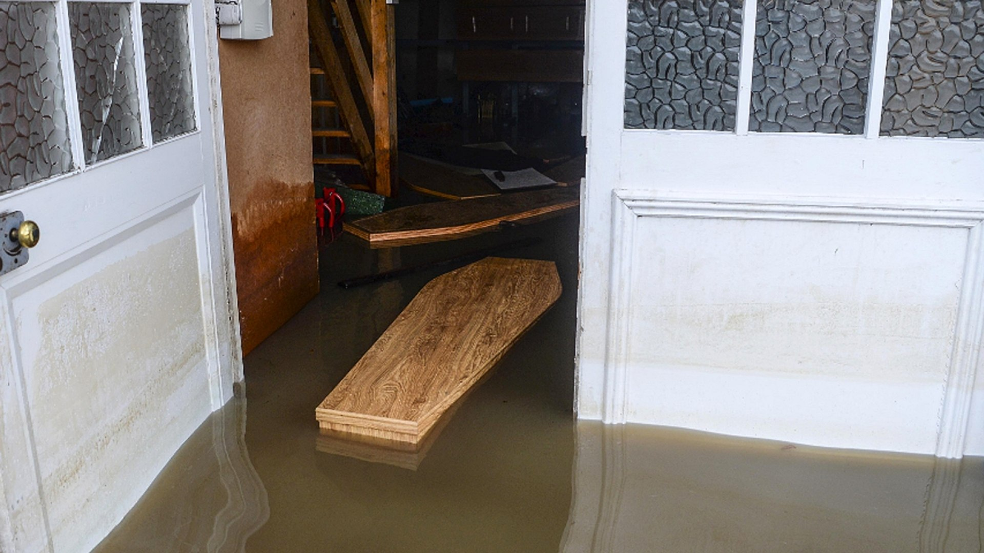 Floodwaters Send Coffins Afloat At U.K. Funeral Home