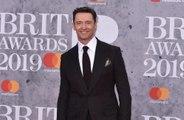 Hugh Jackman mocks Ryan Reynolds in message to John Legend