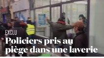 Deux policiers pris au piège dans une laverie face à des manifestants violents