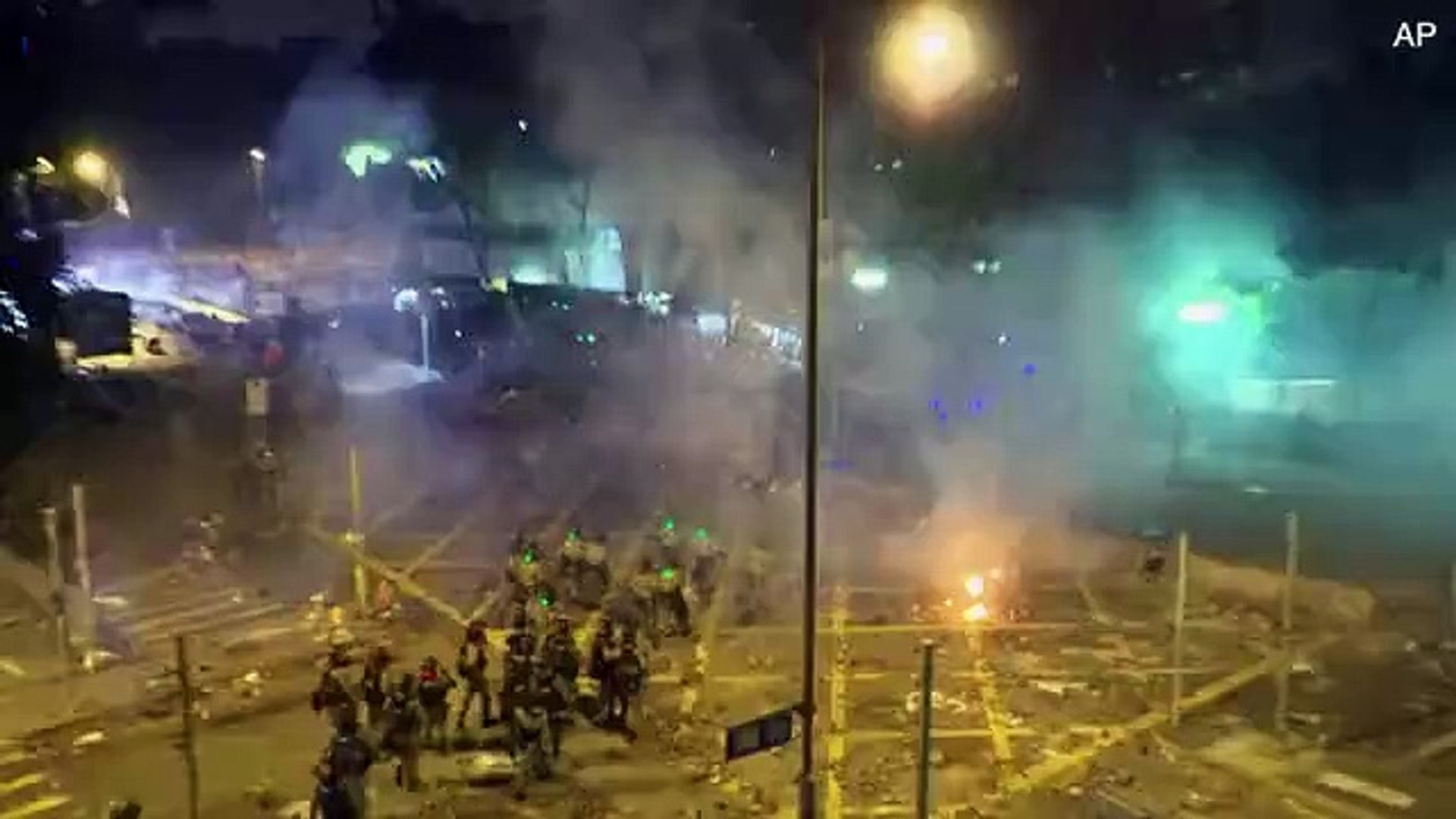 Fiery explosions and fighting as Hong Kong police storm university