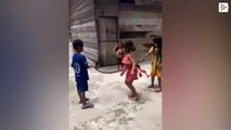 Some Vietnamese kids use a dead snake to jump the rope
