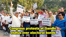 Congress protests at Gandhi statue over electoral bonds at Parliament House
