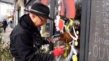 Bourg-en-Bresse: le peintre Géno décore les vitrines des commerces