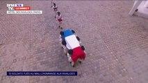 Hommage aux soldats tués au Mali: les treize cercueils quittent la cour des Invalides