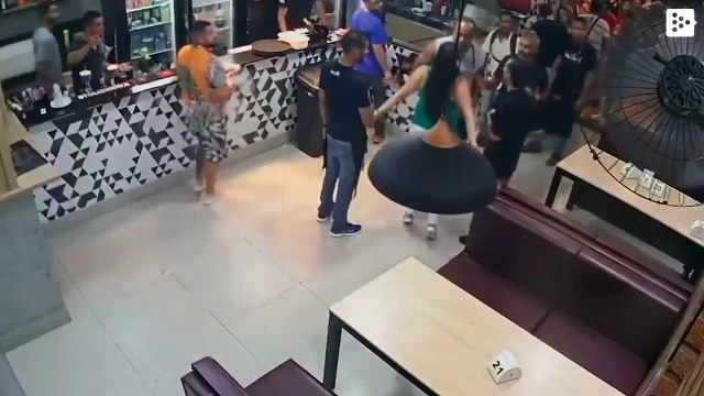 Two men attack a woman in a bar because their tables were too close