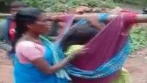 பிரசவத்துக்காக. 6 கி.மீ தொட்டில் பயணம்..கொட்டும் மழையில் தவித்துப்போன கர்ப்பிணி