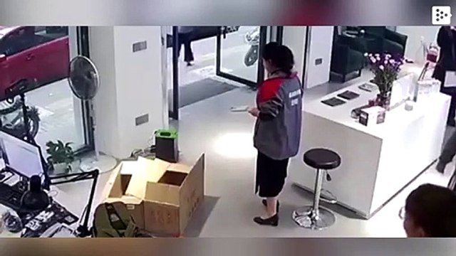 The electric battery of a car that was charging in a store in China explodes