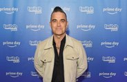 Robbie Williams admits that being middle aged has affected his songwriting