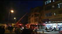 Yangında mahsur kalan 4 kişiyi itfaiye kurtardı