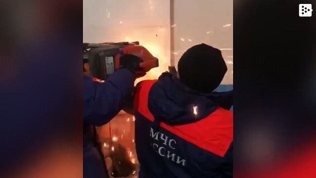 A Siberian falls face down through a ventilation duct from a tenth floor and gets stuck