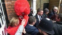 UK election: Woman in giant Elmo suit gatecrashes Jeremy Corbyn's visit to London polling station