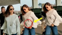 OMG!! Anushka Sharma HIDING HER BABY BUMP In Front Of Media At Airport