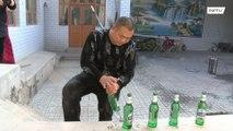 Breaking Dat! Twitter sensation Chinese strongman chugs beer 'tornado' style