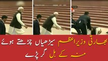 Indian PM Narendra Modi falls on stairs