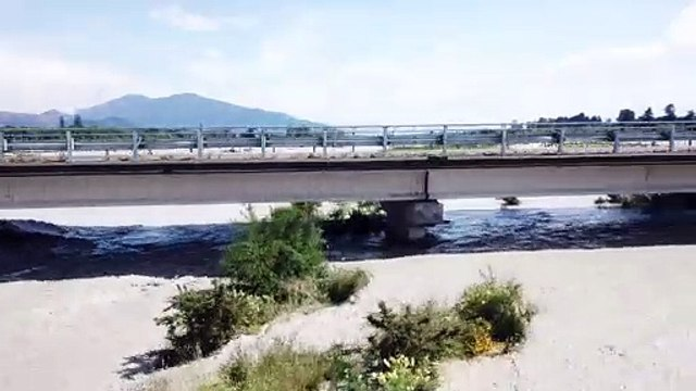 Flooded River Rises To Bridge's Roadway