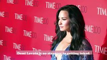Demi Lovato showed off her new tattoo, and we couldn't think of a better word for her