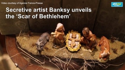 Mysterious artist Banksy unveils dark nativity in Bethlehem