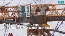 No Christmas Mass at Notre-Dame but topped by a giant crane