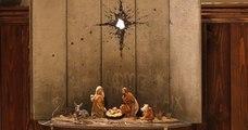 À Bethléem, Banksy dévoile sa crèche de Noël emmurée sous un trou d'obus