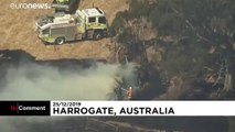 Australian firefighters tackle bushfires on Christmas Day as temperatures ease
