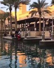 Santa falls into the waterways in Souk Madinat in Dubai