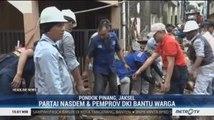 Partai NasDem dan Pemprov DKI Bantu Warga Bersih-bersih Sisa Banjir di Pondok Pinang