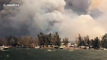 Australians watch their homes burn while evacuating from bushfires on boat