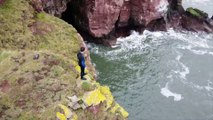 This is the terrifying moment a daredevil backflipped off a massive 66ft cliff