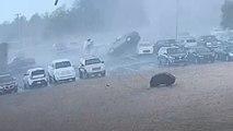 Autos durch die Luft geschleudert: Überwachungskamera filmt Tornado