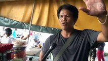 Vendors brave imminent Taal eruption to sell the last of their goods