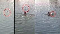 वीडियो: मांझे से कटकर तालाब में तड़प रहा था कबूतर, बेटी चिल्लाई तो पिता ने बचाया कूदकर