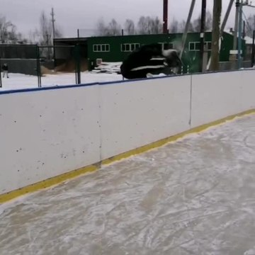 Guy Jumps Off Fence and Falls While Ice Skating