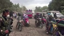 Filipinos salvage belongings as volcano rumbles