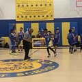 Kid Dances With Referee During Half-Time of Basketball Game