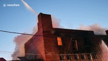 Pennsylvania firefighters attack burning factory in frigid conditions