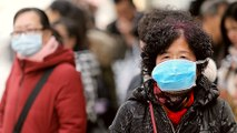 China confirms spread of coronavirus, surge in new infections