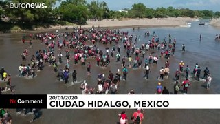 Scuffles as migrants try to cross into southern Mexico