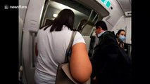 Flights attendants on a Cathay Pacific flight to Hong Kong wear face masks