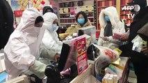 Virus: la population de Wuhan se rue dans les pharmacies
