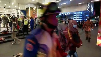 Rescue personnel tending to injured passengers at KLCC station