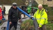 Storm Dennis: Residents in Yorkshire build 'AquaDam'