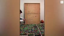A boy pays homage to Kobe Bryant with rubik cubes