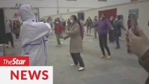 Coronavirus patients, medical staff dance at Wuhan hospital to stay positive
