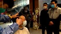 Nurses in Wuhan cut hair to fight against coronavirus outbreak