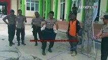 Aksi Polisi Berlatih Tangkap Buaya Berkalung Ban di Palu