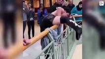 A fighter climbs to the second floor of a mall to jump upon his rivals