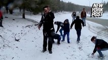 Weatherman pelted with snowballs in hilarious fail