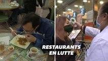 Contre le coronavirus, des restaurants de Hong Kong font manger leurs clients derrière une vitre